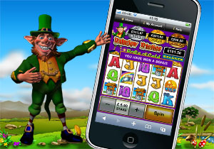Leprechaun next to iPhone with Rainbow Riches